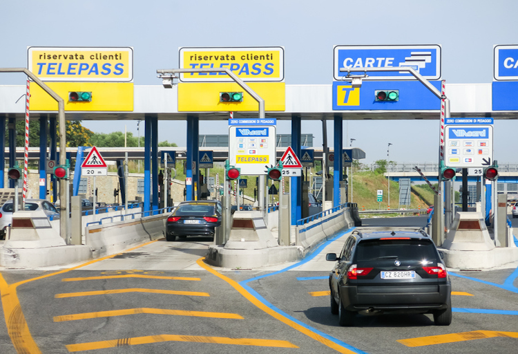 Rome, Italy – July 29, 2013: Cars at toll booths of Autostrade, the motorway to Rome – payment with telepass or card